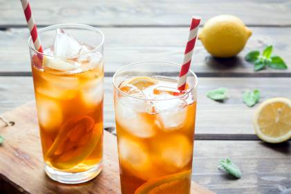 Two refreshing glasses of iced tea with lemon slices
