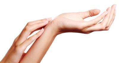 A woman inspecting her fingernails