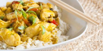 A bowl of curry chicken on jasmine rice