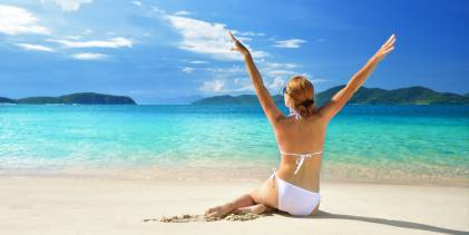 Woman in a good mood on the beach
