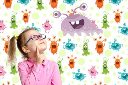 """A little girl looking at some friendly """"good"""" bacteria"""