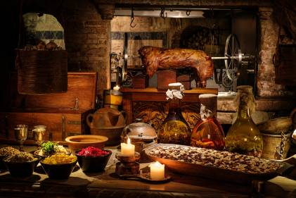 A rustic table set with a medieval feast