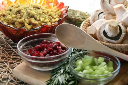 Ingredients to make healthy Thanksgiving side dishes, cranberries, bread for stuffing, celery and mushrooms.