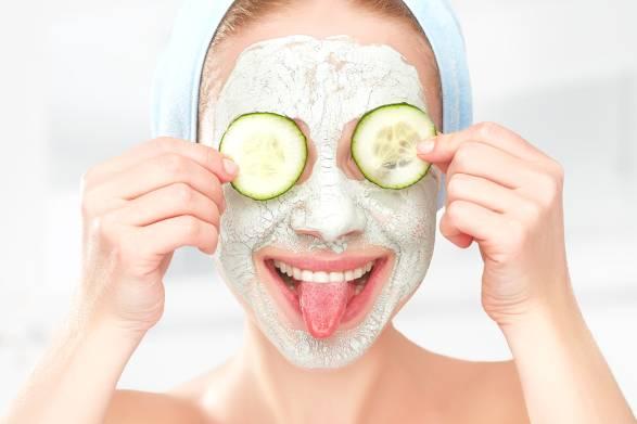 A woman applying natural facial treatment