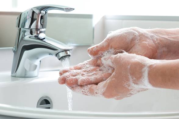 a man washing his hands thoroughly