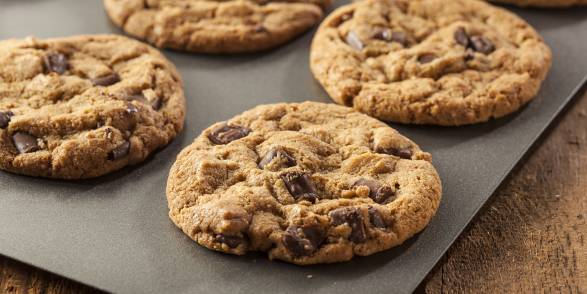 Fresh Peanut Butter Chocolate Chip Cookies on a baking sheet.
