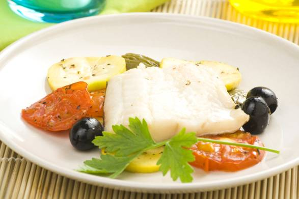 Fillet of cod baked tomatoes and black olives.
