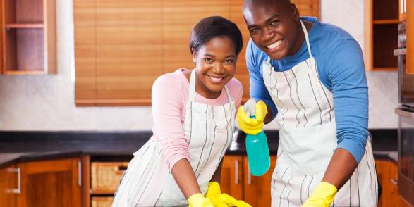 A couple cleaning their home