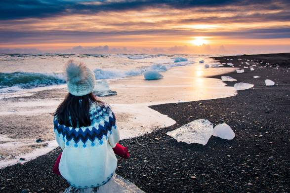 a healthy woman looking out at the cold sea