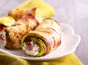 Zucchini Rolls on a white plate ready to enjoy.