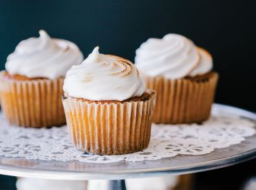 A plate of delicious lemon curd cupcakes with chickpea meringue