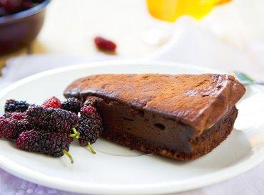Chocolate truffle torte by berries and tea.