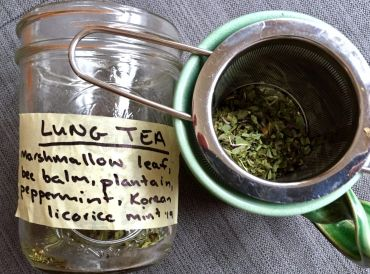 a jar of herbs for making a tea to soothe your lungs