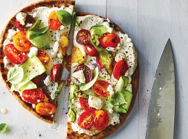 Ricotta and Zucchini Flatbread on a white washed wooden table.